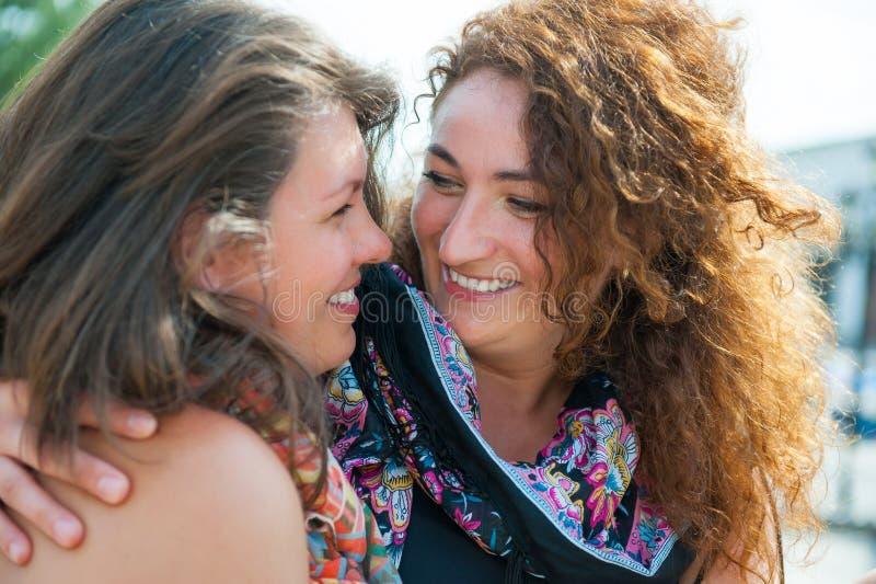 Two happy young beautiful women stock photos