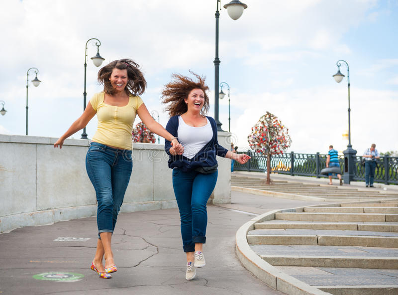Two happy young beautiful women stock photography