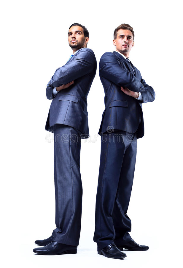 Two happy young businessmen full body. Isolated on white stock photos