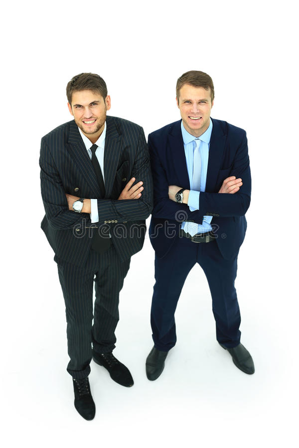 Two happy young businessmen full body stock photo