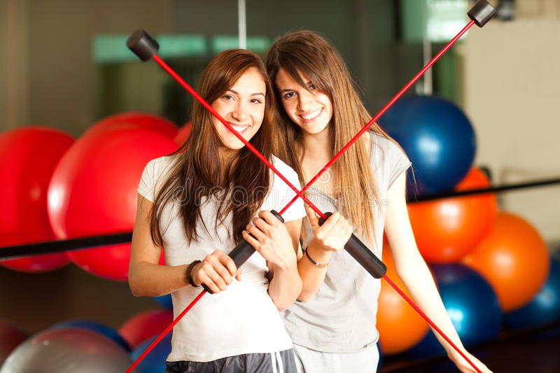 Two happy young women in the gym royalty free stock photography