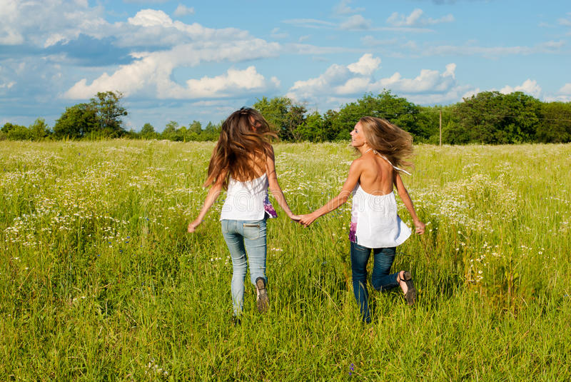 Download Two Happy Young Women Running On Green Field Stock Image - Image: 25513161