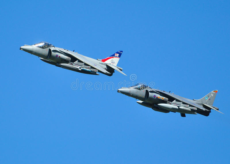 Two Harrier Jump Jets. Flying in Formation royalty free stock image