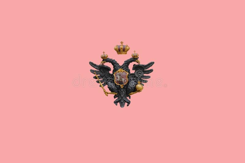 Two headed eagle Symbol isolated on pink background stock photos