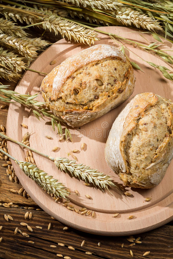 Two healthy buns baked from fresh grain stock photography
