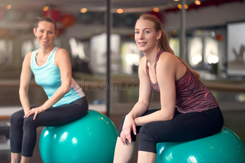 Two healthy young women with pilates balls royalty free stock photography