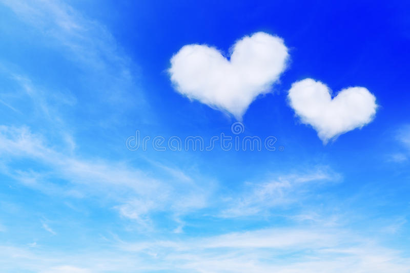 two heart shaped clouds on blue sky for valentine background royalty free stock image