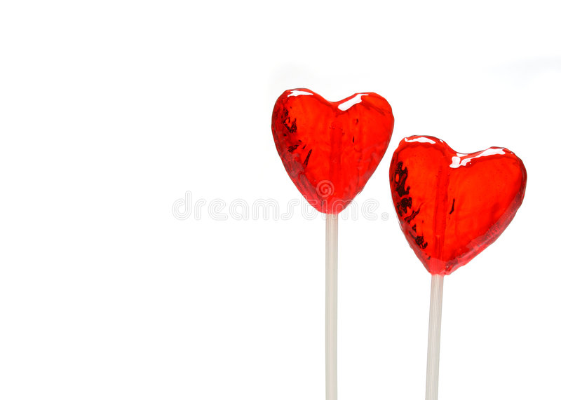 Two heart shaped lollipops for Valentine stock photography