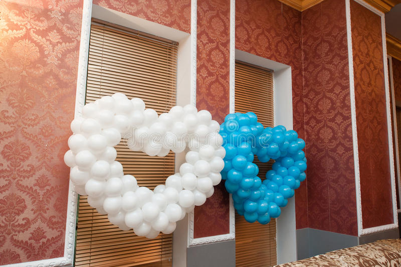 Two hearts of balloons decoration for a wedding in the restaurant royalty free stock images