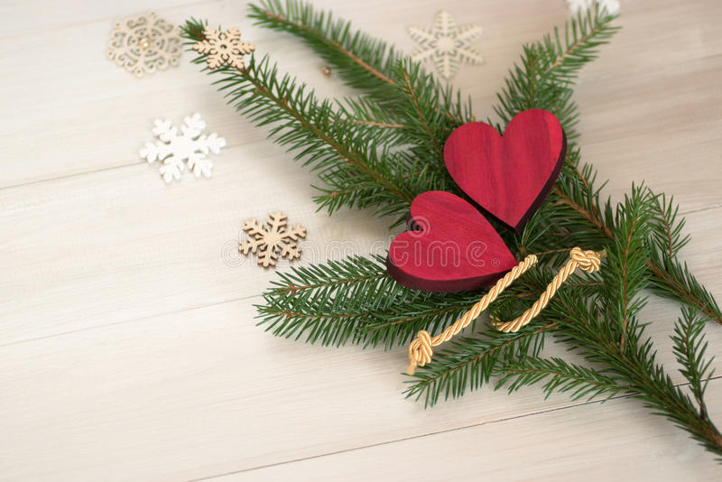 Two hearts with branches of a Christmas tree. royalty free stock image