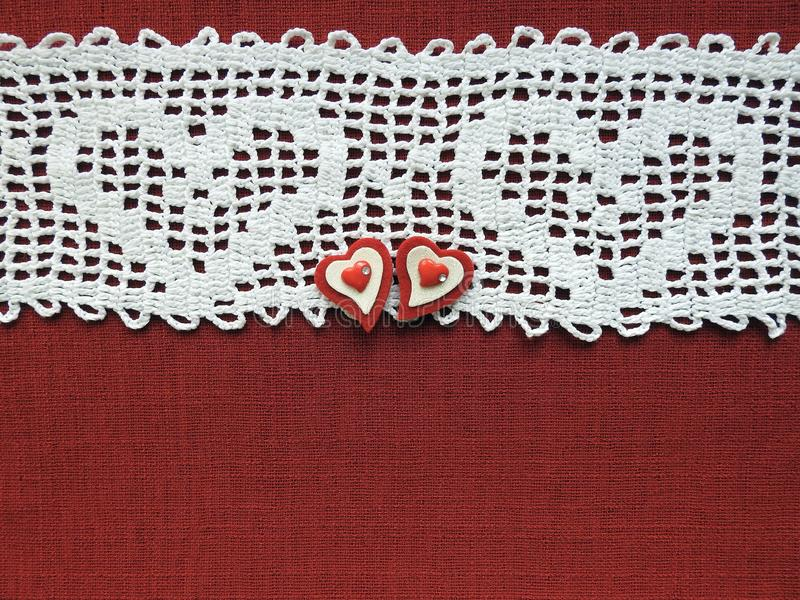 Two hearts on crochet surface for valentine day royalty free stock image