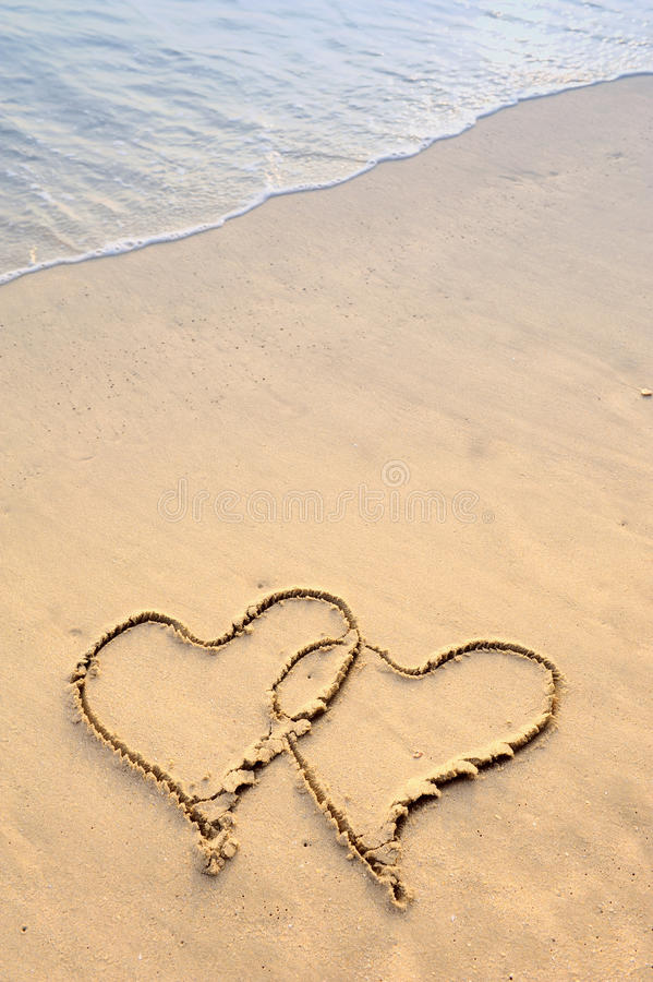 Download Two hearts drawn in beach stock image. Image of serenity - 23252815