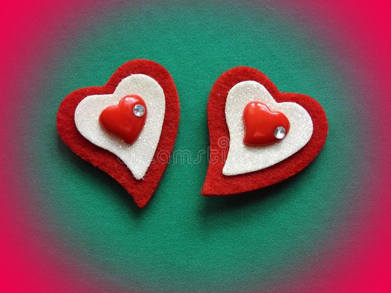 Two hearts on green surface for valentine day stock photo