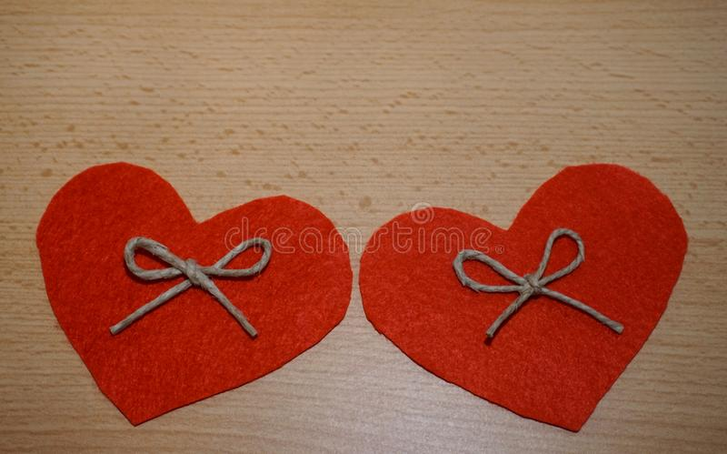 Two hearts made from natural material on wooden background with free copy space stock photos