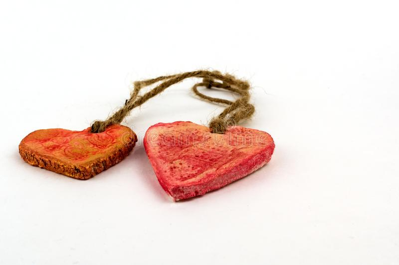 Two hearts on natural handmade rope close-up stock images
