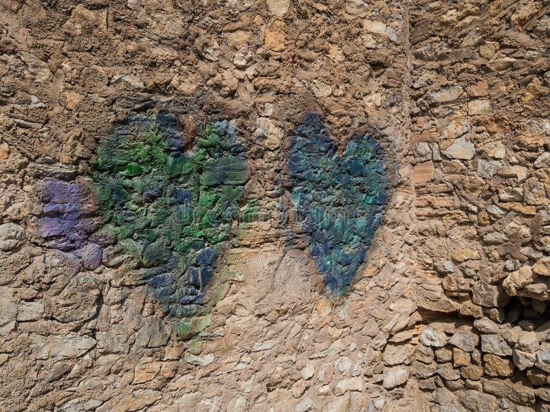 Two hearts on a natural stone wall, arta, mallorca royalty free stock photo