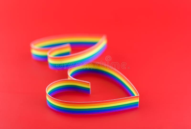 Two hearts,paint of a colour gay flag in red. stock image