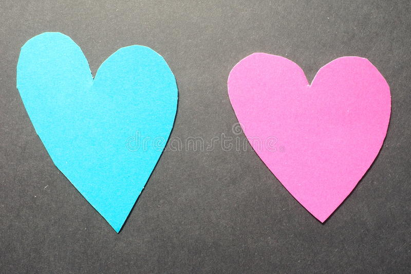 Two hearts. Two real cut out of paper hearts for your romantic or healthcare copy royalty free stock images