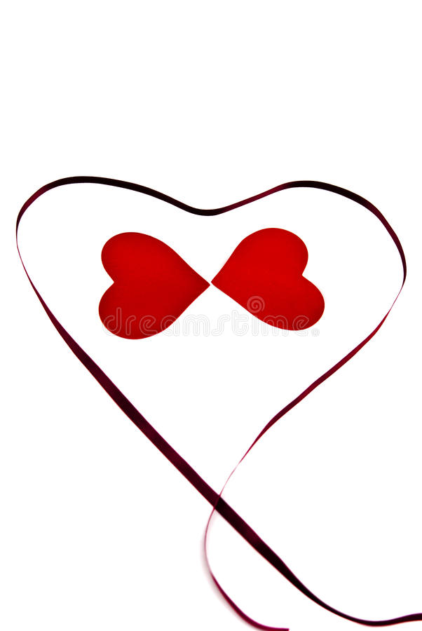 Two hearts and a ribbon. stock photos
