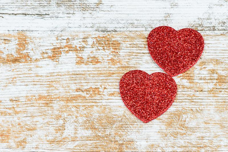 Two hearts on the rustic background. stock photo
