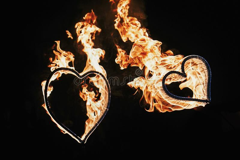 Two hearts shaped firework on black background, fire show in nig stock images