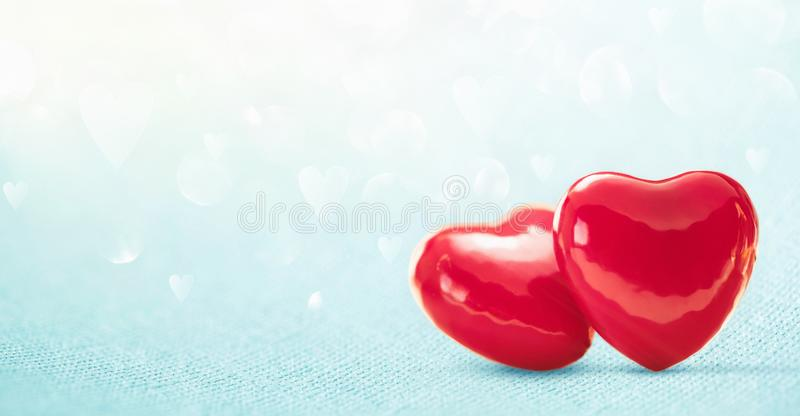 Two Hearts On Shiny Blue Background. Valentines day greeting car stock image