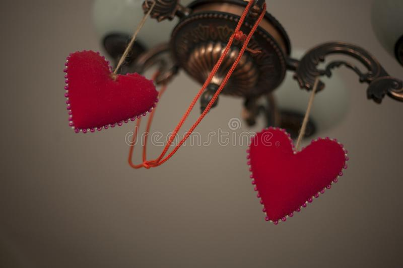 Two hearts symbol of love on a lamp royalty free stock images