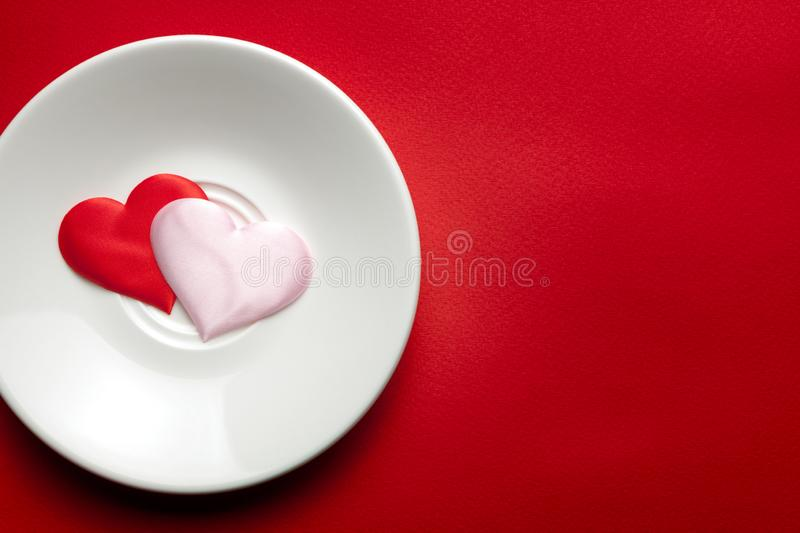 Two hearts at white dish. romance and love concept. copy space. for decor and interior design. healthy lifestyle. lovely hearts. stock image