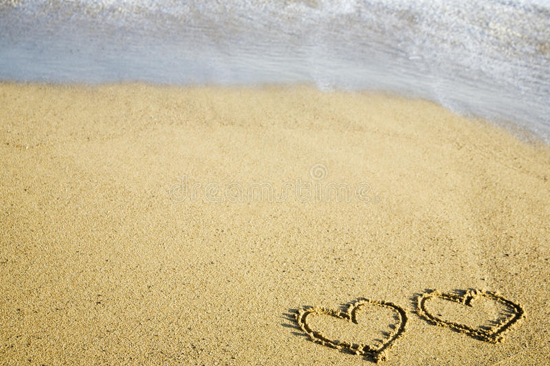 Download Two hearts written on sand stock photo. Image of holiday - 12749268