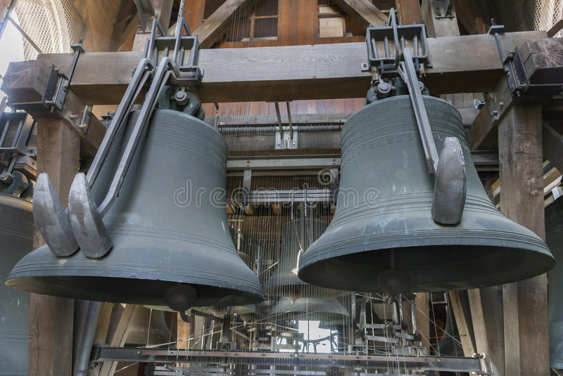 Two heavy bells at the carillon of Ghent Belfry. Two of the heaviest bells of the carillon in the tower of the Ghent Belfry royalty free stock image