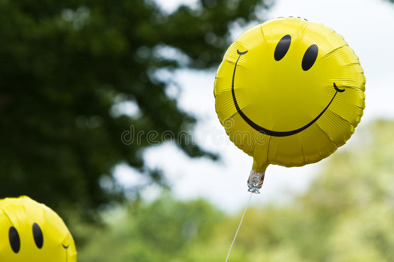 Two helium balloons. Floating in the air royalty free stock photography