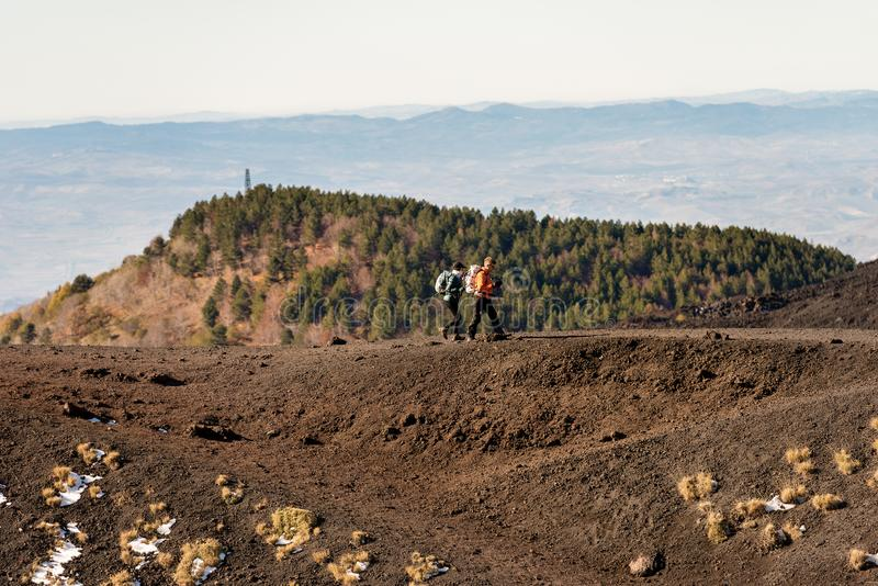 Two Hikers on Mount Etna Volcano - Sicily Italy royalty free stock photo