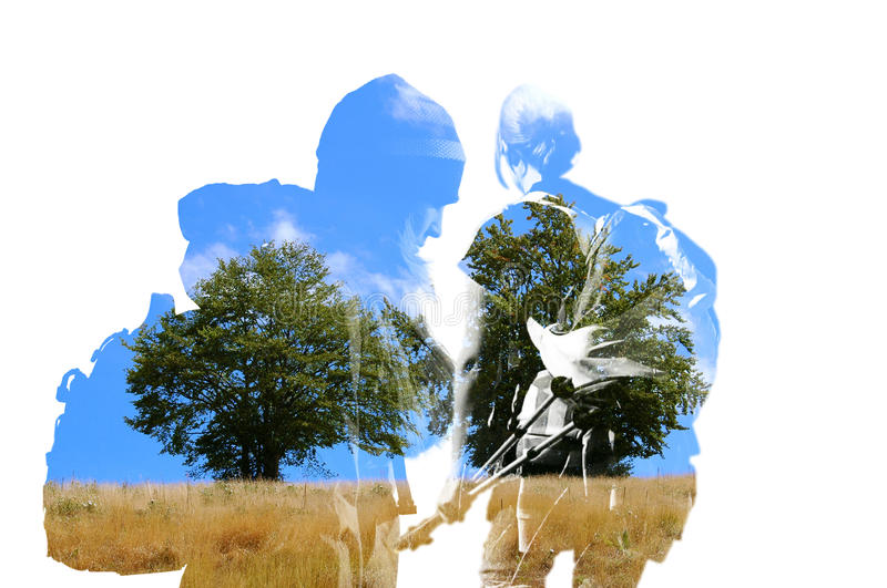 Two hikers and nature silhouette double exposure. Two hikers silhouette with nature double exposure stock photos