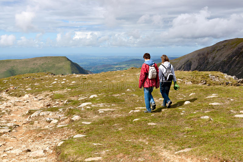 Two hikers walking on Snowdonia stock photography