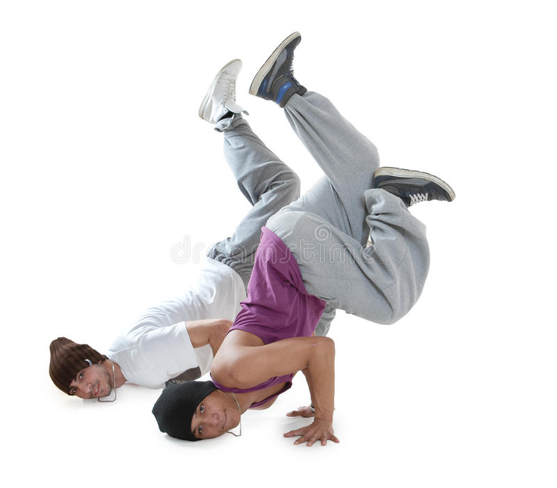 Two hip hop dancers. Two young hip hop dancers posing on white background royalty free stock images