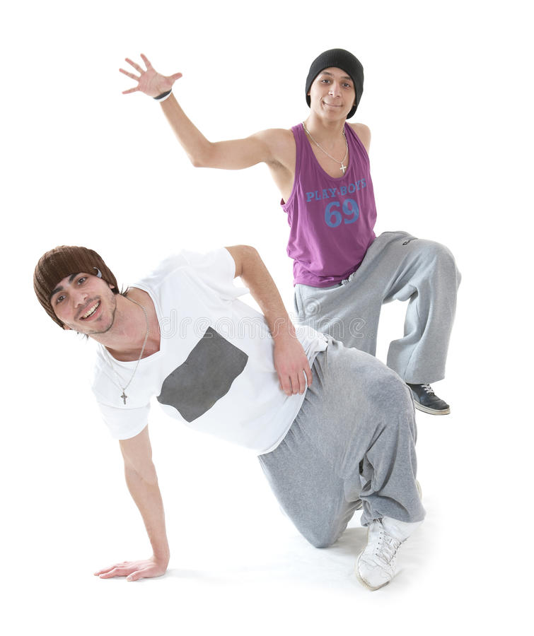 Two hip hop dancers. Two young hip hop dancers posing on white background stock image
