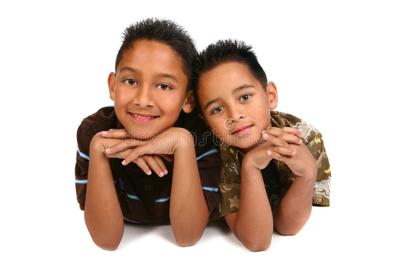 Two Hispanic Young Brothers Smiling. On White Background stock photography