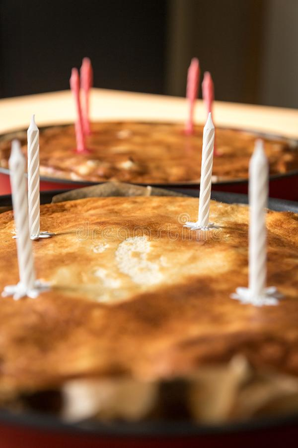 Home-made pie with birthday candles royalty free stock image
