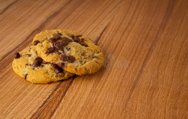 Two homemade cookies with chocolate pieces stock photo