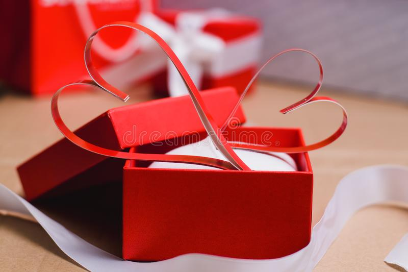 Two homemade paper red hearts in a red gift box, Symbol of Valentine`s Day royalty free stock photos