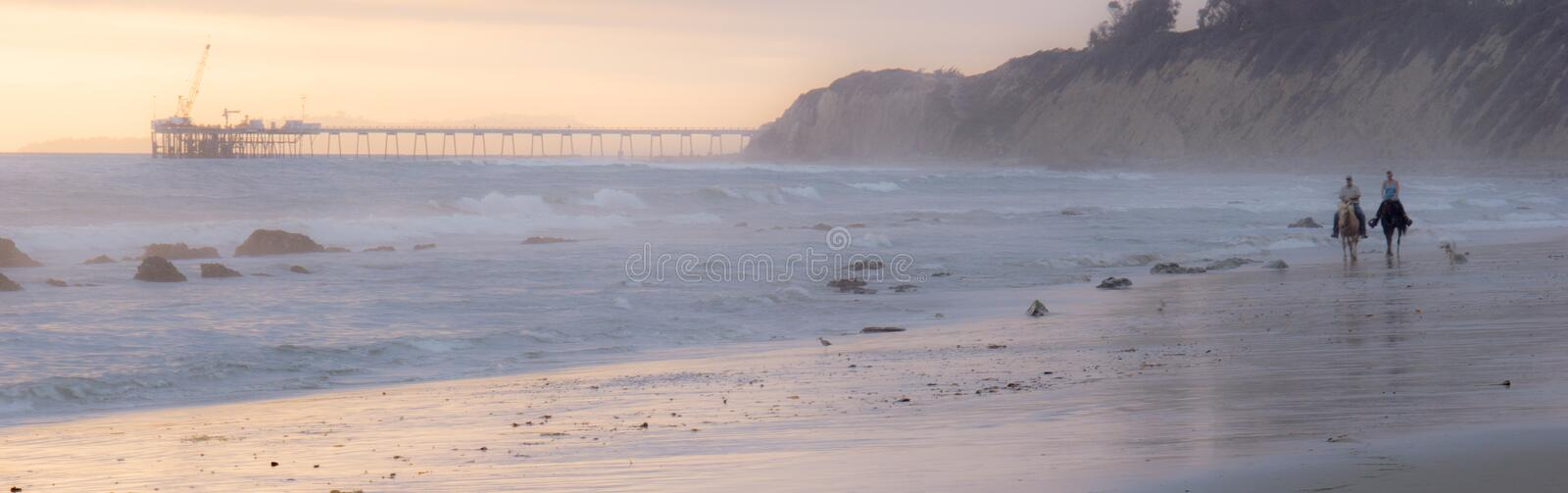 Two Horse Riders on Beach royalty free stock photos