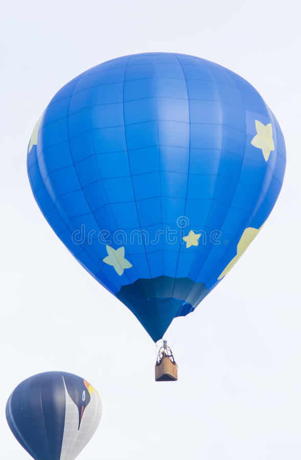 Two hot air balloons flying early morning royalty free stock photo