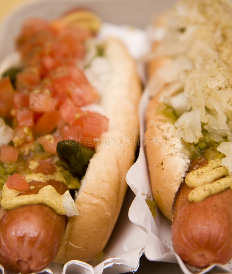 Two Hot Dogs. From a vendor with a variety of toppings stock photography