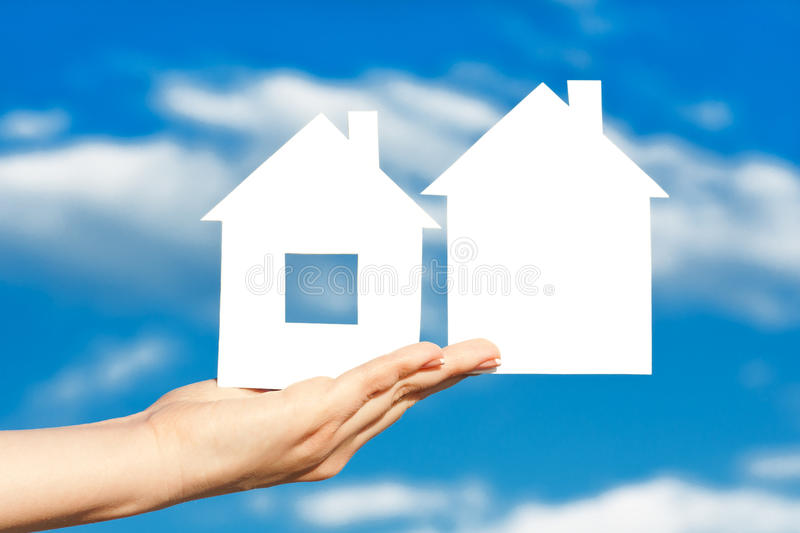 Download Two Houses On The Hand On Blue Sky Stock Image - Image of property, design: 21426751