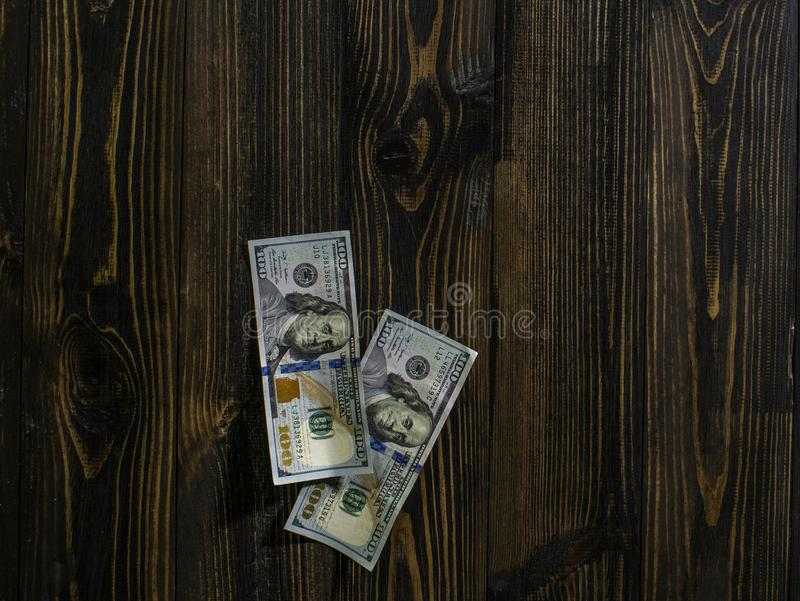 Two hundred dollars bills on a wooden background. new hundred dollar bill. Close up american dollar banknotes stock image