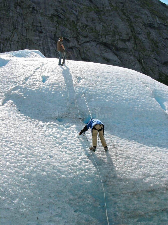 Two ice climbers: teamwork stock photography