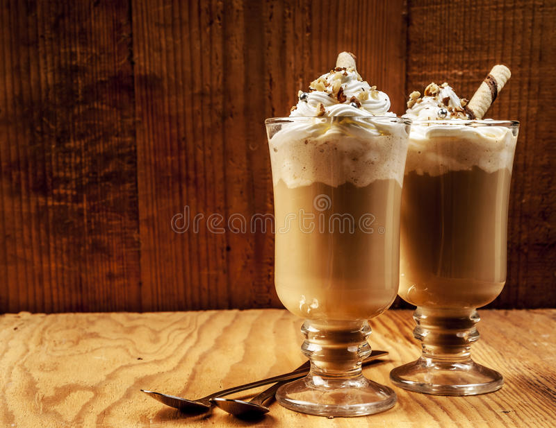 Two ice coffees on wooden background royalty free stock photos