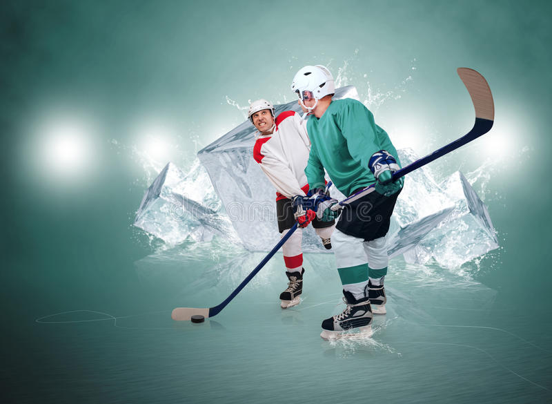 Two ice hockey players with ice cubes background stock images