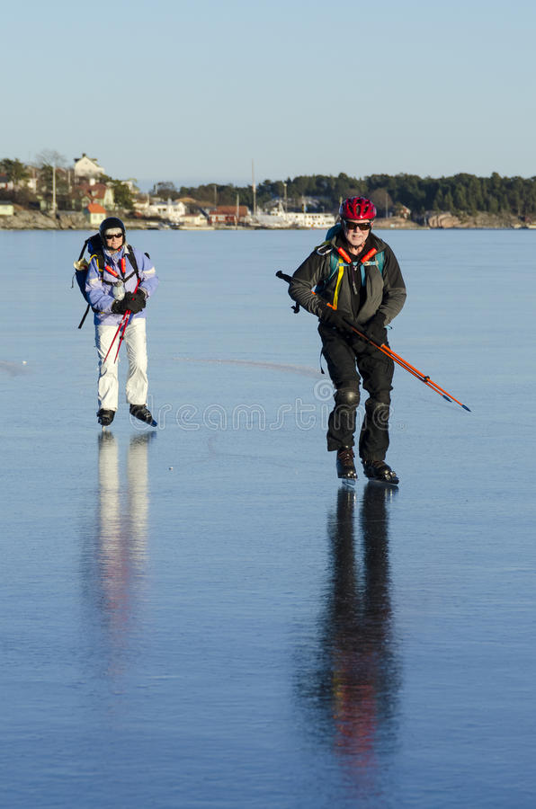 Download Two Ice Skaters On Smoth Ice Stock Image - Image: 29603641