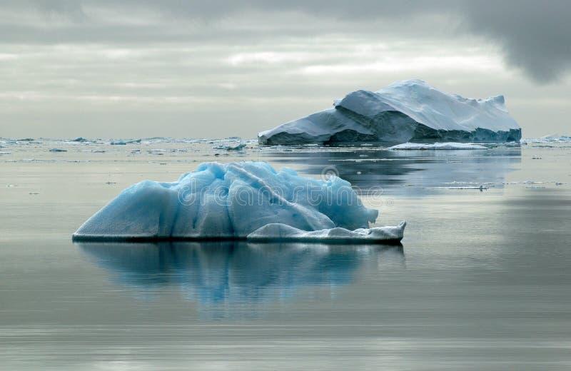 Two icebergs stock photo